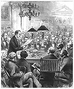 Heinrich Schliemann (1822-1890) Austrian archaeologist, lecturing to the Society of Antiquaries in their rooms at Burlington House, London, on his excavations at Mycenae. Engraving from 'The Illustrated London News', 31 March 1877.