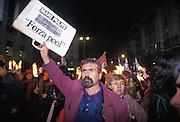 A demonstrator shows a placard reading &quot;Clean Hands now and forever Come on Pool&quot; at a gathering with torches in front of the Palace of Justice to support the work of the pool of magistrates investigating corruption, Milan, 1 December 1994. &copy; Carlo Cerchioli<br /> <br /> Un manifestante mostra un cartello con la scritta &quot;Mani Pulite ora e per sempre Forza Pool&quot; al presidio con fiaccolata di fronte al Palazzo di Giustizia in sostegno del lavoro del pool di magistrati che indagano la corruzione, Milano, 1 dicembre 1994.