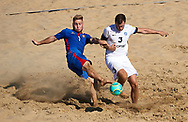 CATANIA, ITALY - AUGUST 16: Ion Telic of Moldova competes for the ball with Joosep Juha of Estonia during the Euro Beach Soccer League match between Moldova and Estonia on August 16, 2019 in Catania, Italy. (Photo by Quality Sport Images