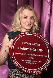 Harry Potter Star, Luna Lovegood, <br /> In the image -  Evanna Lynch.<br /> Actress, Evanna Lynch with another Harry today, Harry Houdini, Actor, Jamie Nichols, at the unveiling of a plaque to Houdini, at the Hippodrome, London, Seen Trying To Escape From The Original Handcuffs Used By Harry Houdini At His Show At The Hippodrome, London, In 1904, London, United Kingdom. Thursday, 3rd October 2013. Picture by i-Images