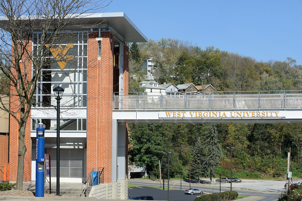 West Virginia University campus, an elevated pedestrain crossover bridge with the university name and logo.