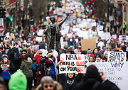 Thousands of demonstrators walk down State Street during the March for our Lives protest in Madison, Wisconsin, Saturday, March 24, 2018.