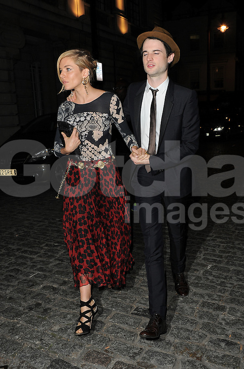 Actress Sienna Miller and Tom Sturridge arriving at the LFW AnOther Magazine party at Loulou's private members club in Mayfair, London, UK. 15/09/2014<br />