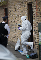 FILE PICTURE © Licensed to London News Pictures. 21/09/2017. London, UK. A police forensics photographer walks from a house belonging to Sabrina Kouider and her partner Ouissem Medouni where police and the fire brigade attended and found the burnt body of their nanny Sophie Lionnet in the garden in Wimbledon, south London. Kouider and Medouni, who are both French nationals, deny murder but have admitted perverting the course of justice by burning the body. Photo credit: Peter Macdiarmid/LNP