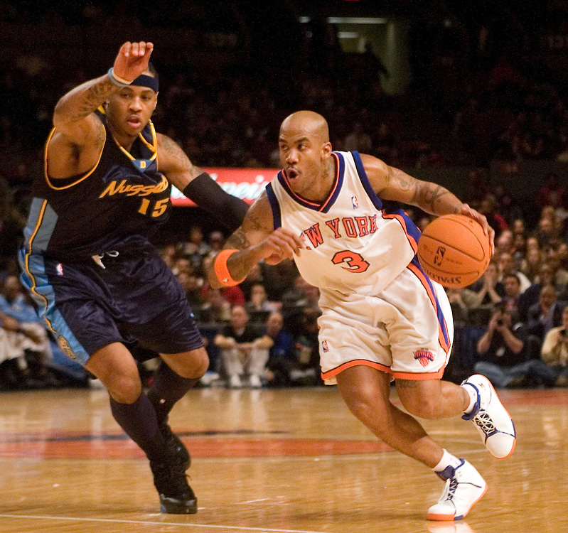 Stephon Marbury of the New York Knicks drives against Carmelo Anthony of the Denver Nuggets at Madison Square Garden, New York on Saturday  16 December 2006. (Andrew Gombert for The New York TImes)<br />