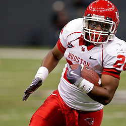 Oct 17, 2009; New Orleans, LA, USA;  Houston Cougars running back Chris Wilson (26) runs with the ball in the second half against the Tulane Green Wave at the Louisiana Superdome. Houston defeated Tulane 44-16. Mandatory Credit: Derick E. Hingle-US PRESSWIRE
