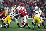 Arizona Cardinals guard Mike Iupati (76) and Arizona Cardinals center Lyle Sendlein (63) double team block Green Bay Packers nose tackle B.J. Raji (90) while Arizona Cardinals tackle Jared Veldheer (68) blocks Green Bay Packers outside linebacker Nick Perry (53) during the NFL NFC Divisional round playoff football game against the Green Bay Packers on Saturday, Jan. 16, 2016 in Glendale, Ariz. The Cardinals won the game in overtime 26-20. (©Paul Anthony Spinelli)