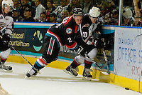 KELOWNA, CANADA, OCTOBER 1: Jesse Lees #2 of the Kelowna Rockets checks Teal Burns #20 of the Vancouver Giants on October 1, 2011 at Prospera Place in Kelowna, British Columbia, Canada (Photo by Marissa Baecker/Getty Images) *** Local Caption ***Jesse Lees;Teal Burns;