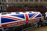 A fuel tanker with the union jack and helping top make Britain greater passes the Mansion House during the Lord Mayor's Show in the City of London. The new Mayor's procession consists of a 3-mile, 150-float parade of commercial and military organisations going back to medieval times. This is the oldest and longest civic procession in the world that has survived the Plague and the Blitz, today one of the best-loved pageants. Henry Fitz-Ailwyn was the first Lord Mayor (1189-1212) and ever since, eminent city fathers (and one woman) have taken the role of the sovereign's representative in the City - London's ancient, self-governing financial district. The role ensured the King had an ally within the prosperous enclave.