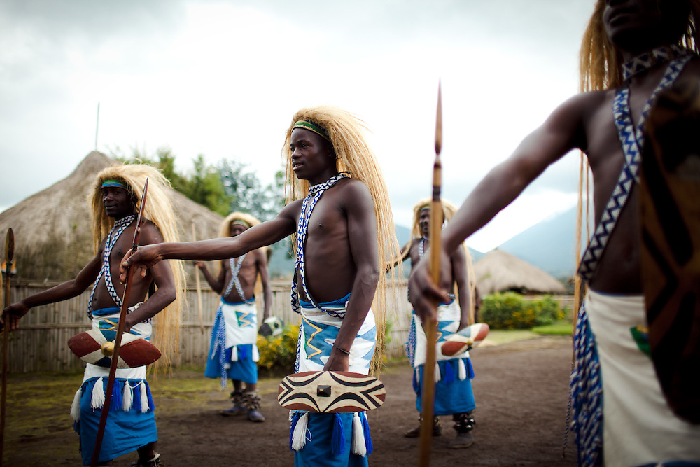 Traditonal tribesman form part of a greating at Iby'Iwacu cultural village