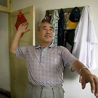 XUZHOU , JULY 22:  Wendi Deng's former volleyball teacher Jiang Limo demonstrates the volleyball spike that .Deng used to protect her husband Ruper Murdoch when he was attacked during the interrogation  related to phone hacking by British MPs ...Deng was a pupil  at the Xuzhou No.1 Middle School and left China 23 years ago.