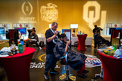 The Oklahoma Sooners get haircuts at the Omni Hotel on Dec. 26, 2019, in Atlanta. Oklahoma will face LSU in the 2019 College Football Playoff Semifinal at the Chick-fil-A Peach Bowl. (Jason Parkhurst via Abell Images for the Chick-fil-A Peach Bowl)