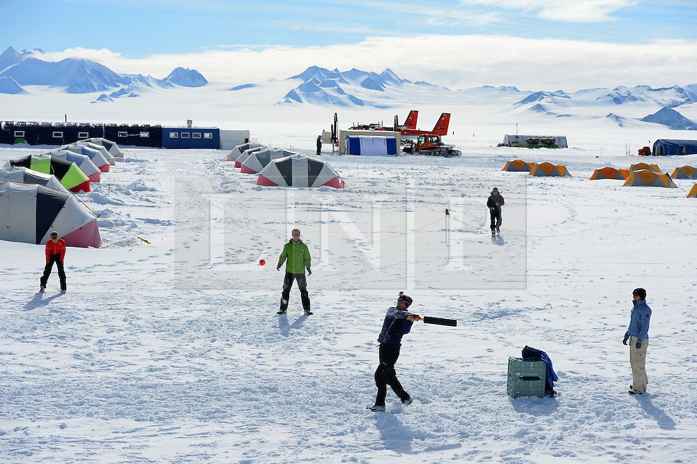 "© Licensed to London News Pictures. Union Glacier, Antarctica. RETIEF JOUBERT resident of Perth, Australia batting. Competitors from the Antarctic Ice Marathon play a game of impromptu ""Ashes"" cricket at the Union Glacier camp, Antarctica ahead of the 2013 Antarctic Ice Marathon, which takes place  just a few hundred miles from the South Pole at the foot of the Ellsworth Mountains.. The majority of players were either Australian and English. It was declared a sporting draw. Photo credit: Mike King/LNP"
