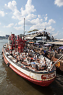 """New York. Lightship Frying Pan  the ultimate """"dive"""" bar, Built in 1929, this historic lightship (one of the few remaining) is said to have spent three years at the bottom of the Chesapeake Bay before being salvaged and brought to Chelsea Piers to become the ultimate """"dive"""" bar. transformed in a bar and restaurant docked along the hudson river  / le frying pan, ancien bateau de lutte contre l'incendie , transforme en bar restaurant a la mode.  Manhattan - Etats-unis"""