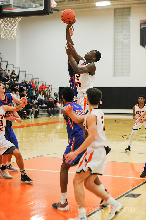 Newton North freshman Kyle Bovell takes the ball to the rim during the game against Newton South at Newton North, Dec. 27, 2018.   [Wicked Local Photo/James Jesson]