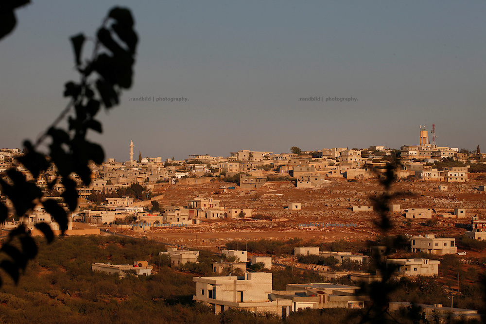 General view on Koreen during sunset.<br /> _ _ _ <br /> Idlib Interim - Challenging life without central government in the village of Koreen (Idlib Province, Syria)<br /> Koreen joint the syrian uprisung to ouster president Bashar al-Assad at a very early stage in 2011. It has been scene of Army attacks and heavy shelling since 2012. In the course of the fightings the village of a few thousend inhabitants was almost abandoned as barrel bomb campaings commited by the regime pounded Koreen. But since regime forces retreated to few bases remaining in Idlib province people returned home to establish a new and almost unregulated economic, social and community life. The regimes power has no affect and can&acute;t reach them anymore. On the other hand a new government isn&acute;t established yet and not in sight at all. Koreen is free to make its way.