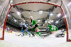 Brian Lebler (EHC Liwest Linz, #7) and Bostjan Groznik (HDD Tilia Olimpija, #6) watching a puck behind Matija Pintaric (HDD Tilia Olimpija, #69) during ice-hockey match between HDD Tilia Olimpija and EHC Liwest Black Wings Linz at fourth match in Semifinal  of EBEL league, on March 13, 2012 at Hala Tivoli, Ljubljana, Slovenia. (Photo By Matic Klansek Velej / Sportida)