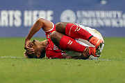 Charlton Athletic attacker Lyle Taylor (9) down injured during the EFL Sky Bet League 1 match between Charlton Athletic and Rochdale at The Valley, London, England on 4 May 2019.
