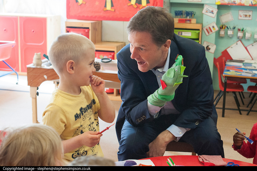 © Licensed to London News Pictures. 24/04/2014. Colchester, UK. 4 year old Dom Bearman laughs after Nick Clegg plays with a hand puppet they made together.  Deputy Prime Minister Nick Clegg visits Hazelmere Infant School and Nannas Day Nursery in Colchester on Thursday 24 April, to talk to teachers and parents about free childcare for two-year-olds, free school meals and the pupil premium.. Photo credit : Stephen Simpson/LNP