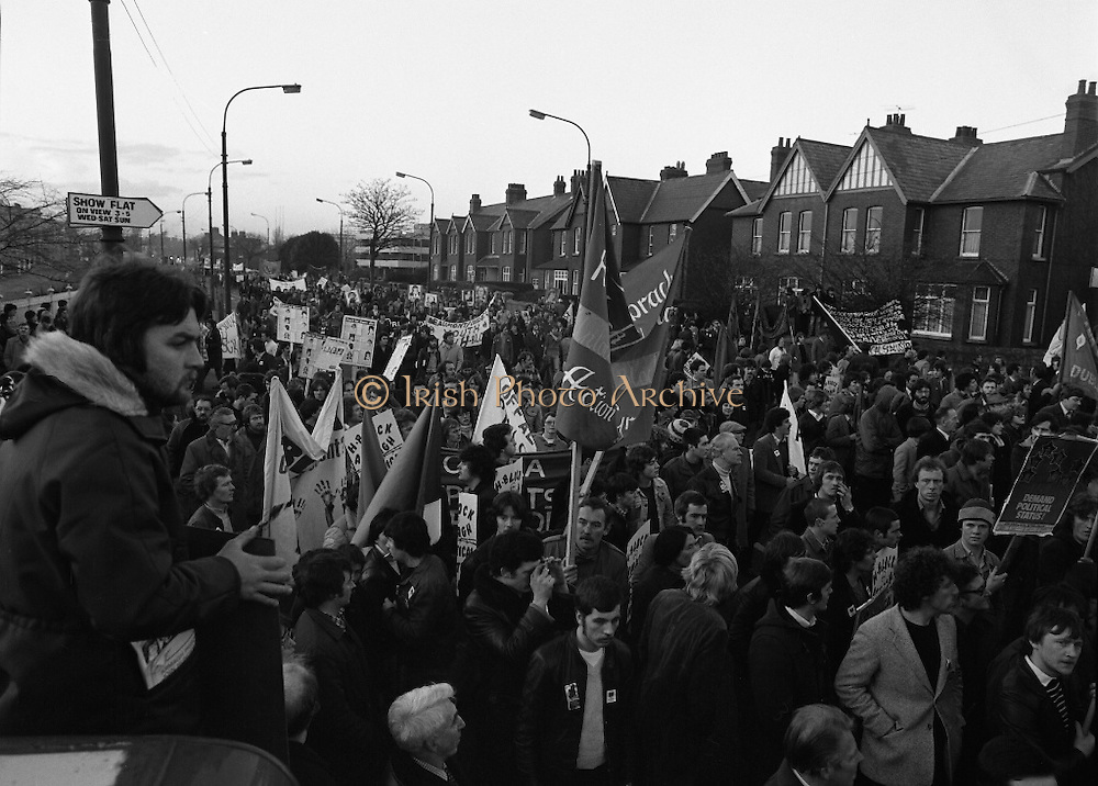 """H-Block Hunger-Strike Protest.   (M54)..1980..06.12.1980..12.06.1980..6th December 1980..In support of the prisioners on hunger strike in Northern Ireland a protest march was organised in Dublin. The march was to highlight the treatment of prisioners who wer on hunger strike and on the """"blanket"""" protest. Part of the prisioner demand was that they be treated as political prisioners and not as criminals or terrorists..A general view of the assembled protestors on Merrion Road."""