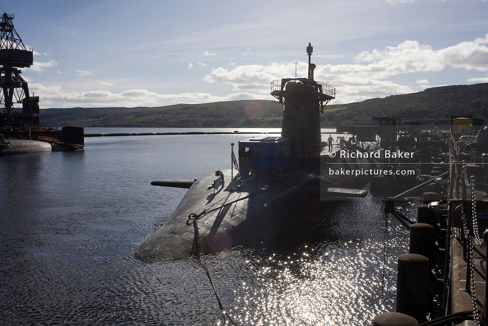 HMS Vigilant, a 15,000 ton Vanguard class nuclear submarine docked at HM Naval Base Clyde, Faslane, Scotland.