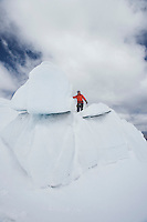 Hiker standing on top ice formation