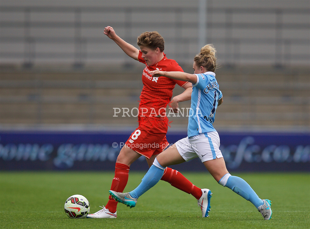 MANCHESTER, ENGLAND - Sunday, August 30, 2015: Liverpool's Katrin Omarsdottir and Manchester City's Isobel Christiansen during the League Cup Group 2 match at the Academy Stadium. (Pic by Paul Currie/Propaganda)