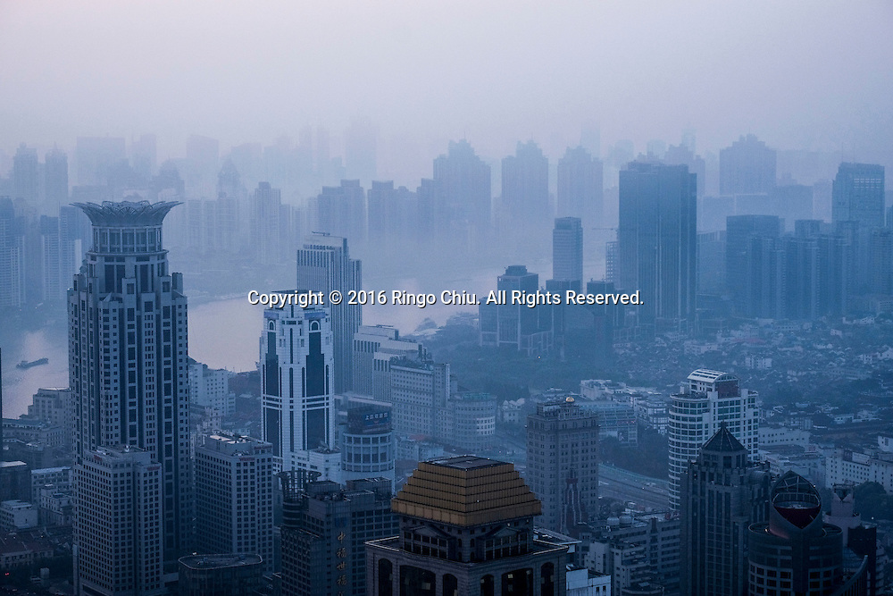 The Shanghai skyline viewed from the Meridien Hotel in Shanghai, China. Shanghai is the most populous city in China and the most populous city proper in the world. It is one of the four direct-controlled municipalities of China, with a population of more than 24 million as of 2014. It is a global financial centre, and a transport hub with the world's busiest container port. Located in the Yangtze River Delta in East China, Shanghai sits on the south edge of the mouth of the Yangtze in the middle portion of the Chinese coast. The municipality borders the provinces of Jiangsu and Zhejiang to the north, south and west, and is bounded to the east by the East China Sea. A major administrative, shipping, and trading town, Shanghai grew in importance in the 19th century due to trade and recognition of its favourable port location and economic potential. The city was one of five forced open to foreign trade following the British victory over China in the First Opium War while the subsequent 1842 Treaty of Nanking and 1844 Treaty of Whampoa allowed the establishment of the Shanghai International Settlement and the French Concession. The city then flourished as a center of commerce between China and other parts of the world (predominantly Western countries), and became the primary financial hub of the Asia-Pacific region in the 1930s. However, with the Communist Party takeover of the mainland in 1949, trade was limited to socialist countries, and the city's global influence declined. In the 1990s, the economic reforms introduced by Deng Xiaoping resulted in an intense re-development of the city, aiding the return of finance and foreign investment to the city. Shanghai has been described as the &quot;showpiece&quot; of the booming economy of mainland China; renowned for its Lujiazui skyline, museums and historic buildings, such as those along The Bund, the City God Temple and the Yu Garden.(Photo by Ringo Chiu/PHOTOFORMULA.com)<br /> <br /> Usage Notes: This content is intended for editorial use on