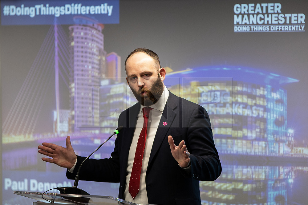 "© Licensed to London News Pictures. 07/01/2019. Manchester, UK. Mayor of Salford PAUL DENNETT . The Metro Mayor of Greater Manchester Andy Burnham announces a revised plan for new housing (some on greenbelt land) , transport infrastructure , the reduction of pollution and improvements to the environment across the North West , alongside the regeneration of Stockport Town Centre , at an event at etc Venues in Manchester City Centre . The new "" Spatial Framework "" also reaffirms the region's commitment to ban fracking and lists 50,000 new "" affordable "" homes (30,000 of which are specified as social housing) . Photo credit: Joel Goodman/LNP"