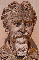 Close-up of a bas relief of a man with a goatee beard on in a grave on Isola San Michel, Venice, Italy.