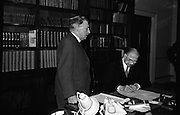 Dissolution of Dáil Eireann..1965..18.03.1965..03.18.1965..18th March 1965..The proclaimation to dissolve the Dail was signed by President Eamon de Valera and An Taoiseach Seán Lemass at a short formal ceremony at Áras an Uachtarain...Image shows President Eamon DeValera signing the dissolution order as An Taoiseach, Mr Sean Lemass TD looks on.