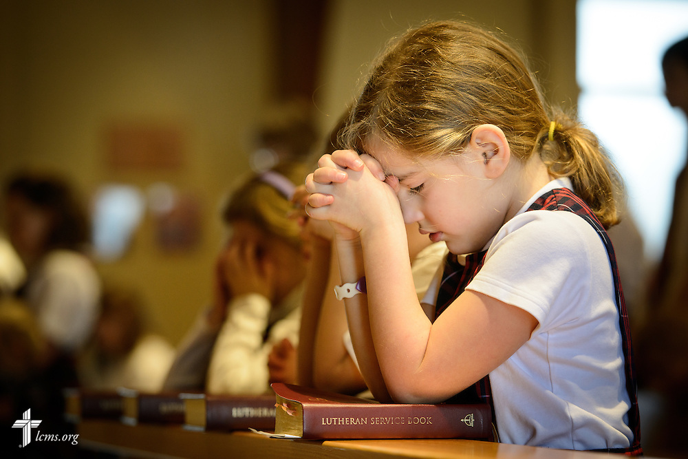 Rachel Raffa joins other students in prayer during morning chapel at Peace Lutheran Academy, part of Peace Lutheran Church in Sussex, Wis., on Monday, Feb. 8, 2016. LCMS Communications/Erik M. Lunsford