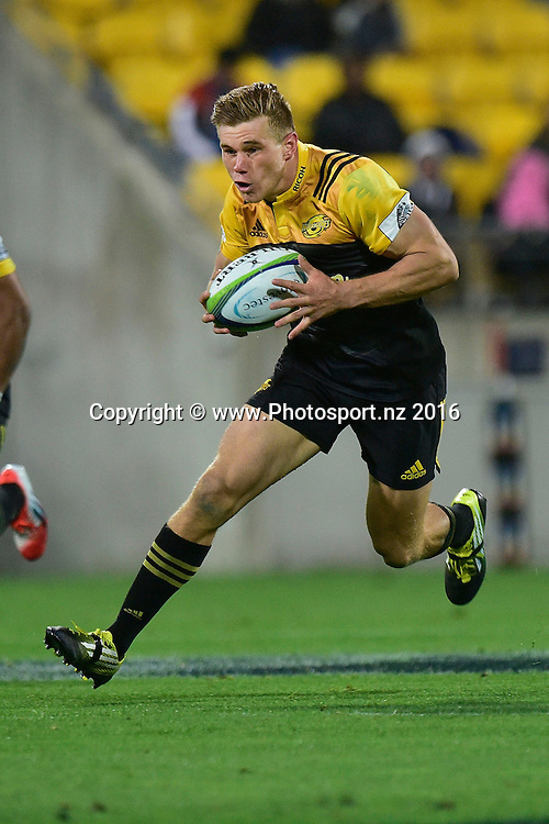 Jason Woodwad of the Hurricanes runs with the ball during the Hurricanes vs Kings Super Rugby  match at the Westpac Stadium in Wellington on Friday the 25th of March 2016. Copyright Photo by Marty Melville / www.Photosport.nz