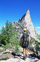 Man with backpack approaching peak&#xA;<br />