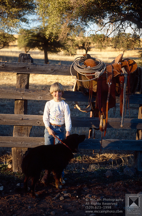 Nancy Maria Salge with dog, corral, Vera Earl Ranch, near Sonoita, Arizona.©1991 Edward McCain. All rights reserved. McCain Photography, McCain Creative, Inc.