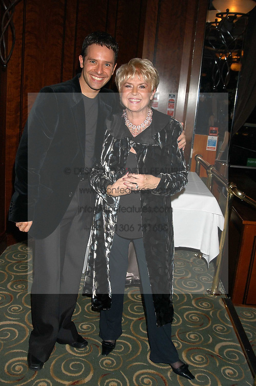 GLORIA HUNNIFORD and her dance partner in the forthcoming BBC TV programme Strickley Come Dancing 3  DARREN BENNETT at a party to celebrate the publication of 'Next To You' - Caron's Courage remembered by her mother Gloria Hunniford held on Caron's birthday at The Hilton Park Lane, London on 5th Octobe 2005.<br />