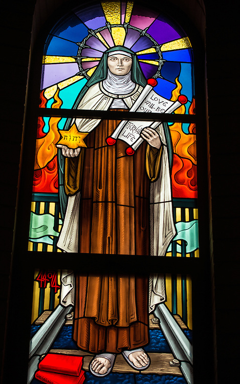 "A stained glass image of St. Teresa Benedicta, at the Carmelite monastery in Denmark, Wis. holding a scroll with the words ""Love will be our eternal life."" (Sam Lucero photo)"