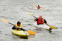 Adam Bates Guinness Northern Counties Youth Coordinator Kayaking  with Kids from the  Guinness Northern Counties Briary Close housing scheme in Wakefield at Pugneys Country Park on Thursday  26 August 2010 .Images © Paul David Drabble..