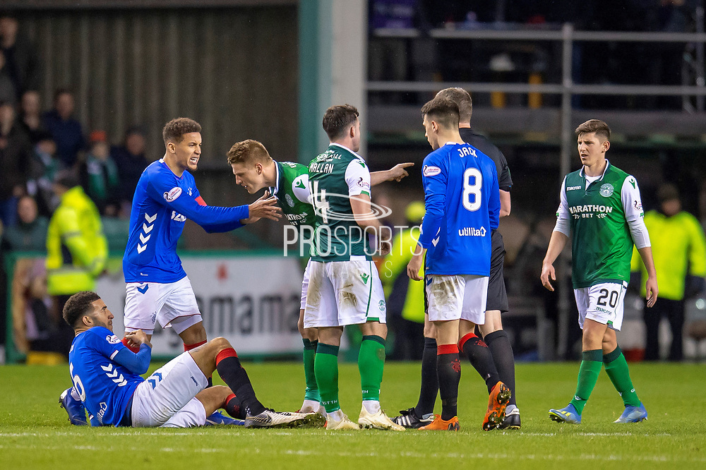 Vykintas Slivka (#8) of Hibernian FC confronts Connor Goldson (#6) of Rangers FC during the Ladbrokes Scottish Premiership match between Hibernian and Rangers at Easter Road, Edinburgh, Scotland on 19 December 2018.