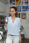 Reality TV dating star Andi Dorfman celebrates her recent move to New York City with a housewarming event at the Painting Lounge hosted by Palm Breeze, a new tropical sparkling alcohol spritz from Mike's Hard Lemonade Co., Thursday, Aug. 6, 2015 in New York.  (Diane Bondareff/AP Images for Palm Breeze)