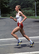 Norwegian marathon runner and Olympic gold and silver medalist Grete Waitz runs in the L'eggs Mini-Marathon in New York City's Central Park on May 30, 1981 New York, New York. ©Paul Anthony Spinelli