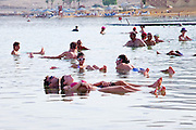 Israel, Dead Sea People float in the heavy water of the Dead Sea