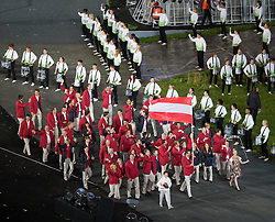 27.07.2012, Olympia Park, London, GBR, Olympia 2012, Eroeffungsfeier, im Bild das Oesterreichische Team mit Fahnentraeger Markus Rogan // the Austrian Team with Markus Rogan during opening ceremony at the 2012 Summer Olympics at Olympic Park London, United Kingdom on 2012/07/27. EXPA Pictures © 2012, PhotoCredit: EXPA/ Johann Groder
