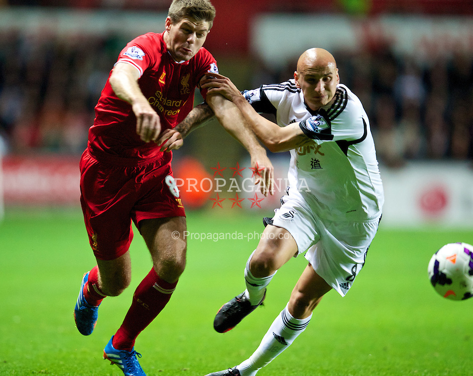 SWANSEA, WALES - Monday, September 16, 2013: Liverpool's captain Steven Gerrard in action against Swansea City's Jonjo Shelvey during the Premiership match at the Liberty Stadium. (Pic by David Rawcliffe/Propaganda)