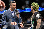 """LONDON, ENGLAND, MARCH 8, 2014: Dan Hardy interviews Louis Gaudinot during """"UFC Fight Night: Gustafsson vs. Manuwa"""" inside the O2 Arena in Greenwich, London on Saturday, March 8, 2014 (© Martin McNeil)"""