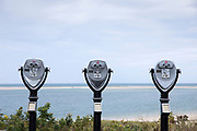 Pay to view binoculars make odd sculptures at Chatham viewpoint over the Atlantic Ocean, Cape Cod New England, USA