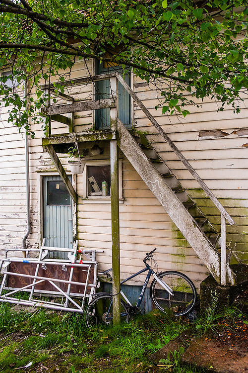 An unusually unkempt corner of a garden in the old town part of Stavanger, Norway