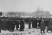 Funeral of Revolutionary fighters in Petrograd, later St Petersburg, 5th April 1917, with coffins carried by soldiers, students and workers, photograph published in L'Illustration no.3869, 28th April 1917. Picture by Manuel Cohen