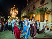 25 MARCH 2016 - BANGKOK, THAILAND: Parishioners participate in a procession carrying the body of Christ past the church during Good Friday observances at Santa Cruz Church in Bangkok. Santa Cruz was one of the first Catholic churches established in Bangkok. It was built in the late 1700s by Portuguese soldiers allied with King Taksin the Great in his battles against the Burmese who invaded Thailand (then Siam). There are about 300,000 Catholics in Thailand, in 10 dioceses with 436 parishes. Good Friday marks the day Jesus Christ was crucified by the Romans and is one of the most important days in Catholicism and Christianity.      PHOTO BY JACK KURTZ