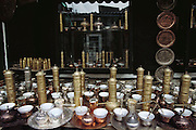 One of many shops in old Sarajevo that sell tea and coffee sets, pepper grinders and decorated plates, as well as items fashioned from discarded brass military shell casings. Bosnia and Herzegovina. ©2005 Hungry Planet: What the World Eats